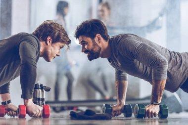 sportsmen doing push ups