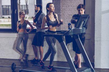sportswoman running on treadmill