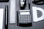 Photo calculator with various office utensils