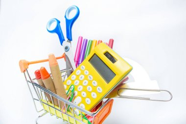 Different colorful school supplies in shopping cart isolated on white stock vector