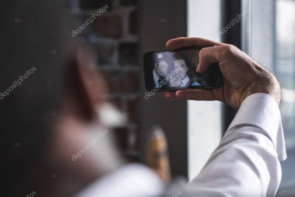 business colleagues taking selfie together on digital  smartphone