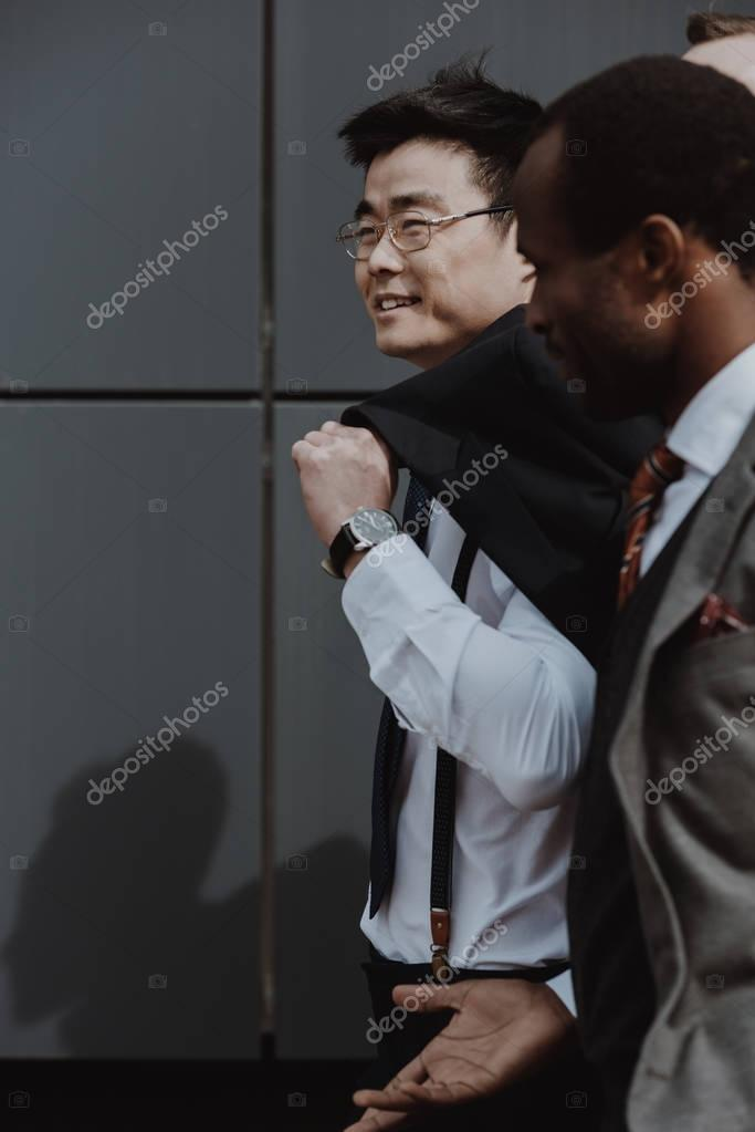happy stylish multicultural business team walking outdoors, business people team concept