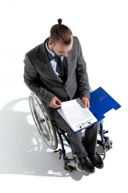 businessman in wheelchair looking at contract