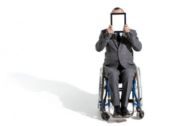 physically handicapped businessman with digital tablet