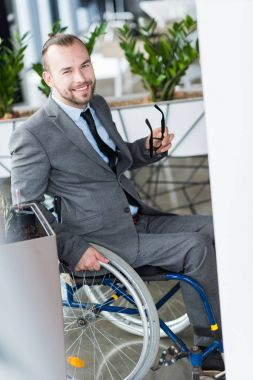 physically handicapped businessman looking at camera