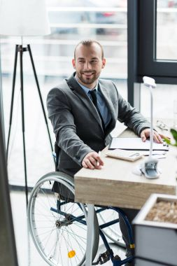physically handicapped businessman in suit at office