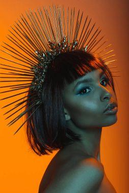 african american woman posing in headpiece