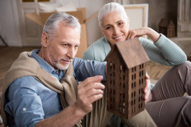couple looking at house model