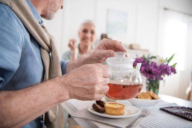senior couple drinking tea during breakfast