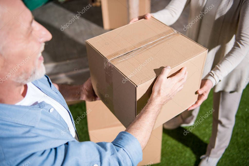 Senior couple with cardboard box