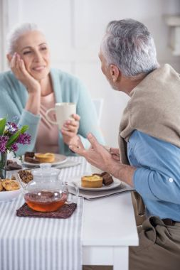 senior couple talking and having breakfast