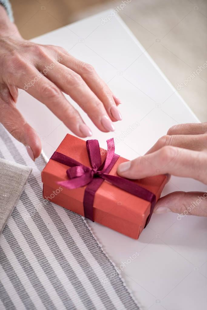 man presenting gift to wife