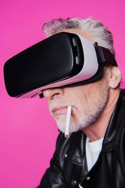 Close-up portrait of bearded senior man with cigarette in mouth using virtual reality headset stock vector