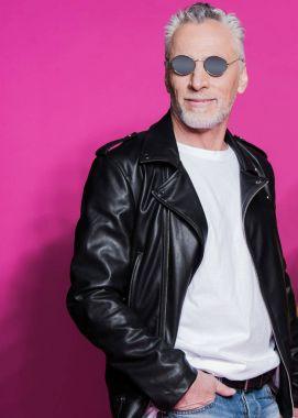 Senior man in leather jacket