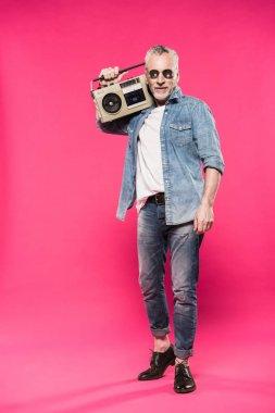man holding tape recorder