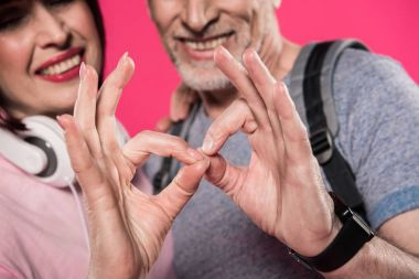 couple showing okay sign together