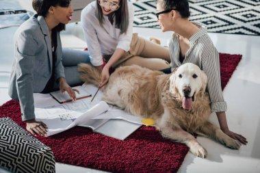 Businesswomen working with blueprints