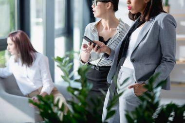 Businesswomen using smartphone
