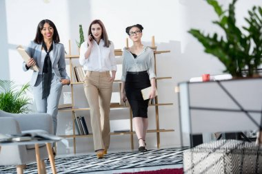 young multiethnic businesswomen walking at office