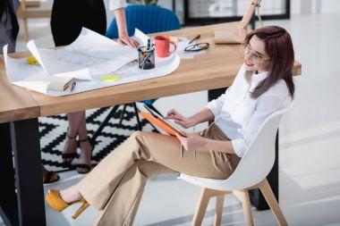 Caucasian designer working with digital tablet