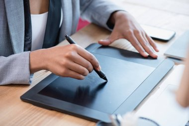 designer drawing on graphics tablet at workplace