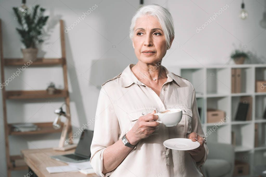 businesswoman with coffee at office