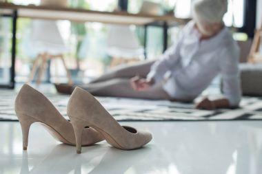 Stilettos and senior businesswoman