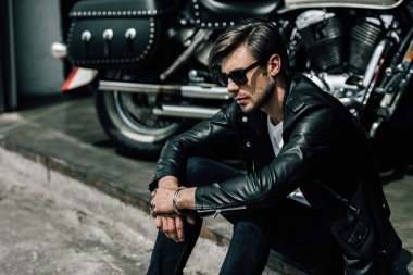 Stylish man with motorbike