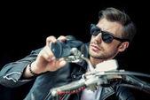 Stylish man with motorbike