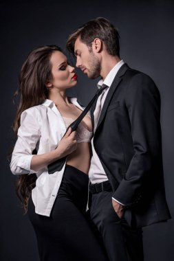 girl seducing man in formal wear