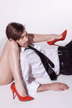 woman in stilettos lying with elegant man