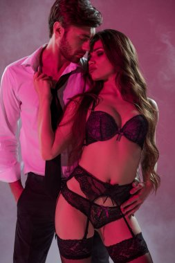 sexy woman in lingerie seducing man