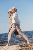 Fotografie Altes Paar zu Fuß am Strand