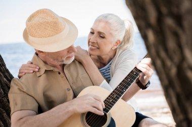 Senior couple with guitar