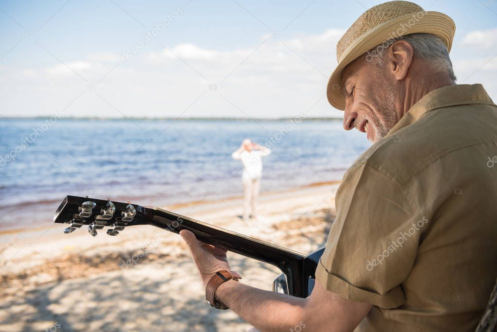 Senior man with guitar