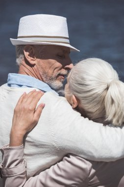 casual elderly couple able to kiss