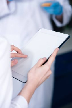 Scientist working with digital tablet