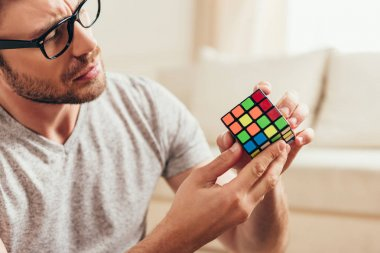Young man with rubik cube