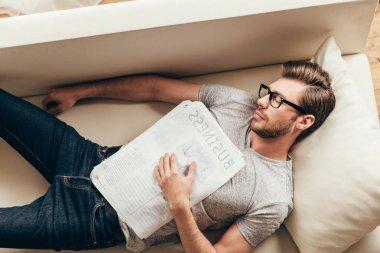 young caucasian man sleeping at home