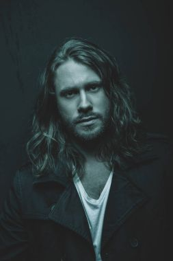 Handsome long haired man