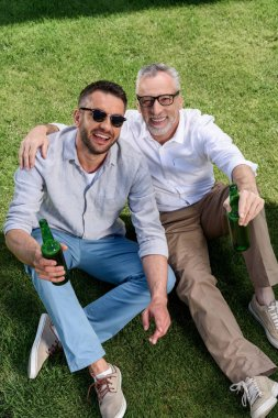 father and adult son drinkig beer