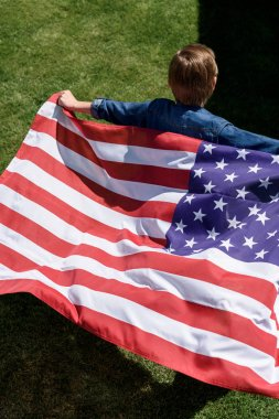 boy running with american flag