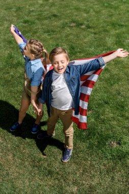 siblings with american flag