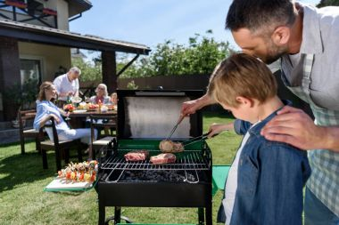 Happy family at barbecue