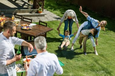 family spend time during barbecue
