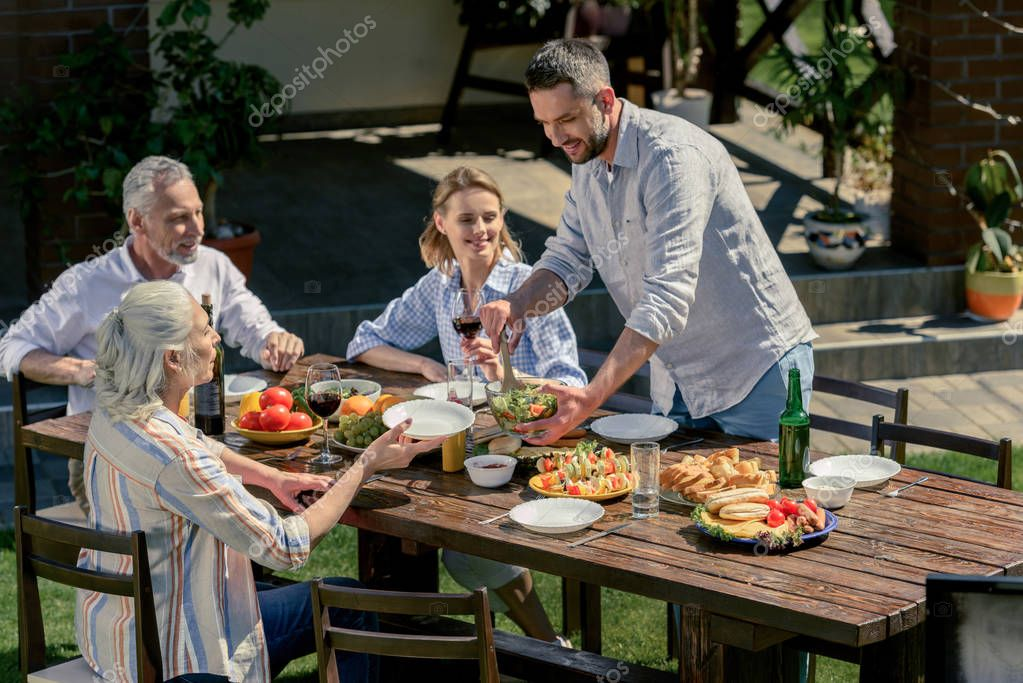 family spending time together on picnic