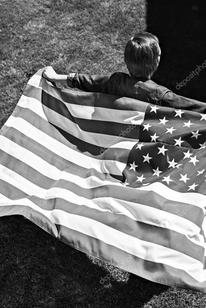boy running with american flag