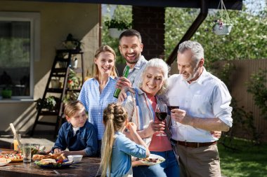 smiling family having picnic on patio