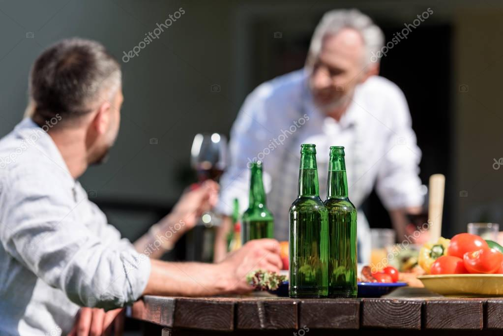 family talking during lunch on patio