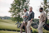 Fotografie golfers on golf course